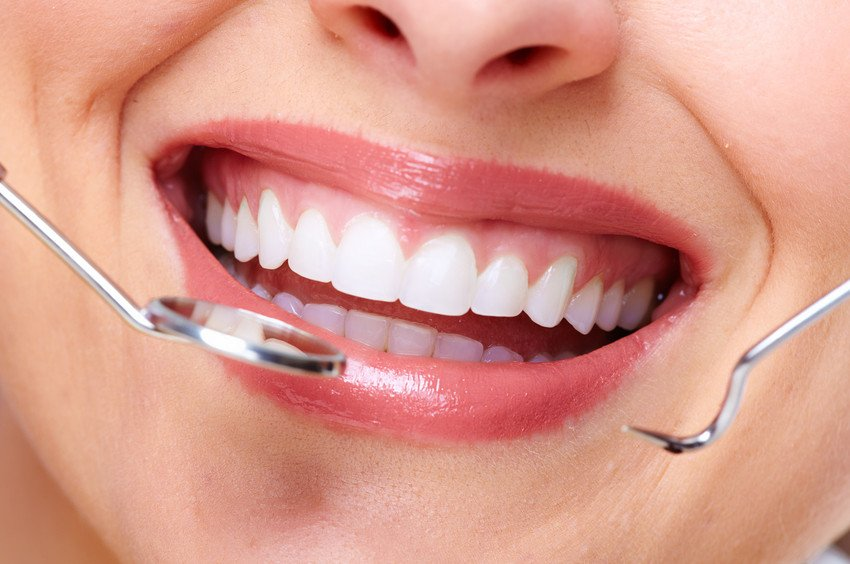 A healthy smile with dental instruments
