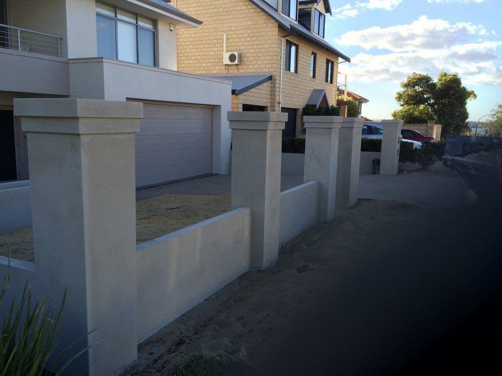 white stone fence