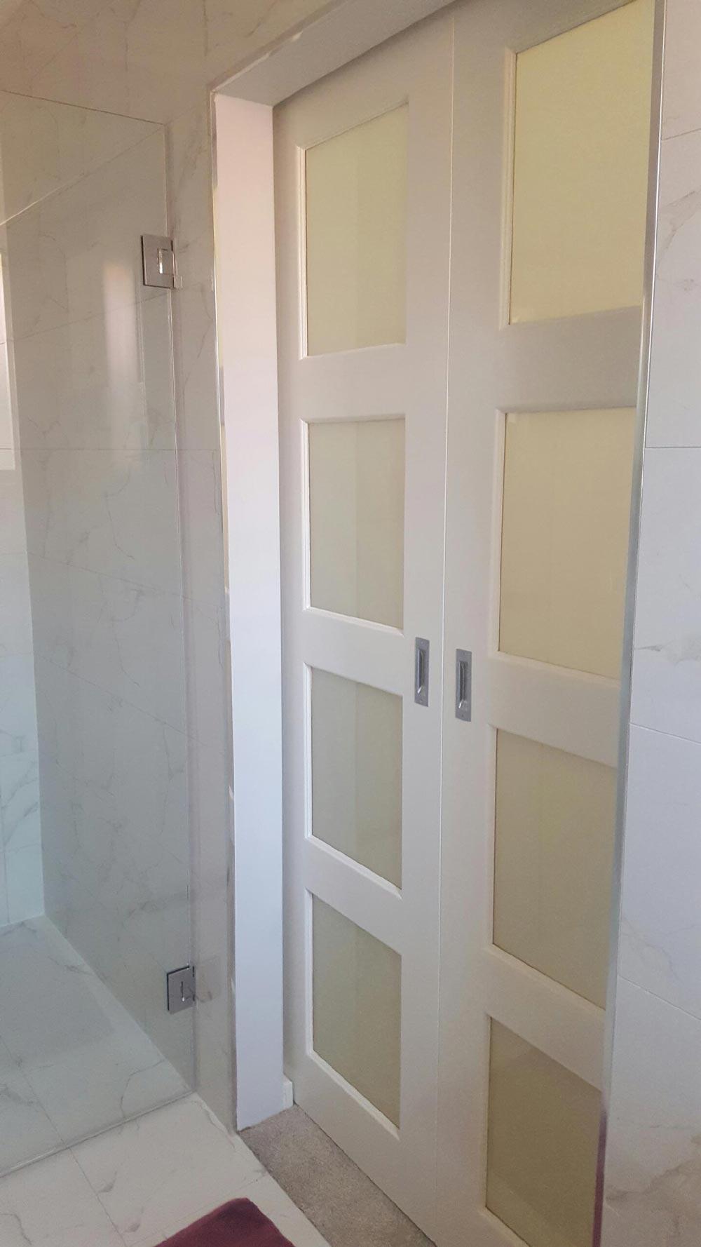 sliding white glass door