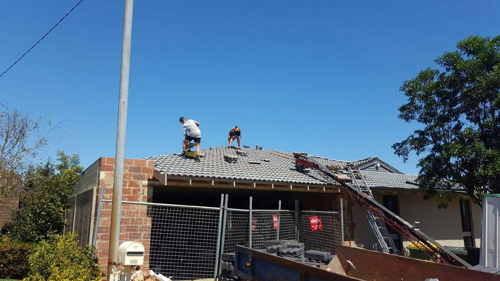 shingles being placed on the roof