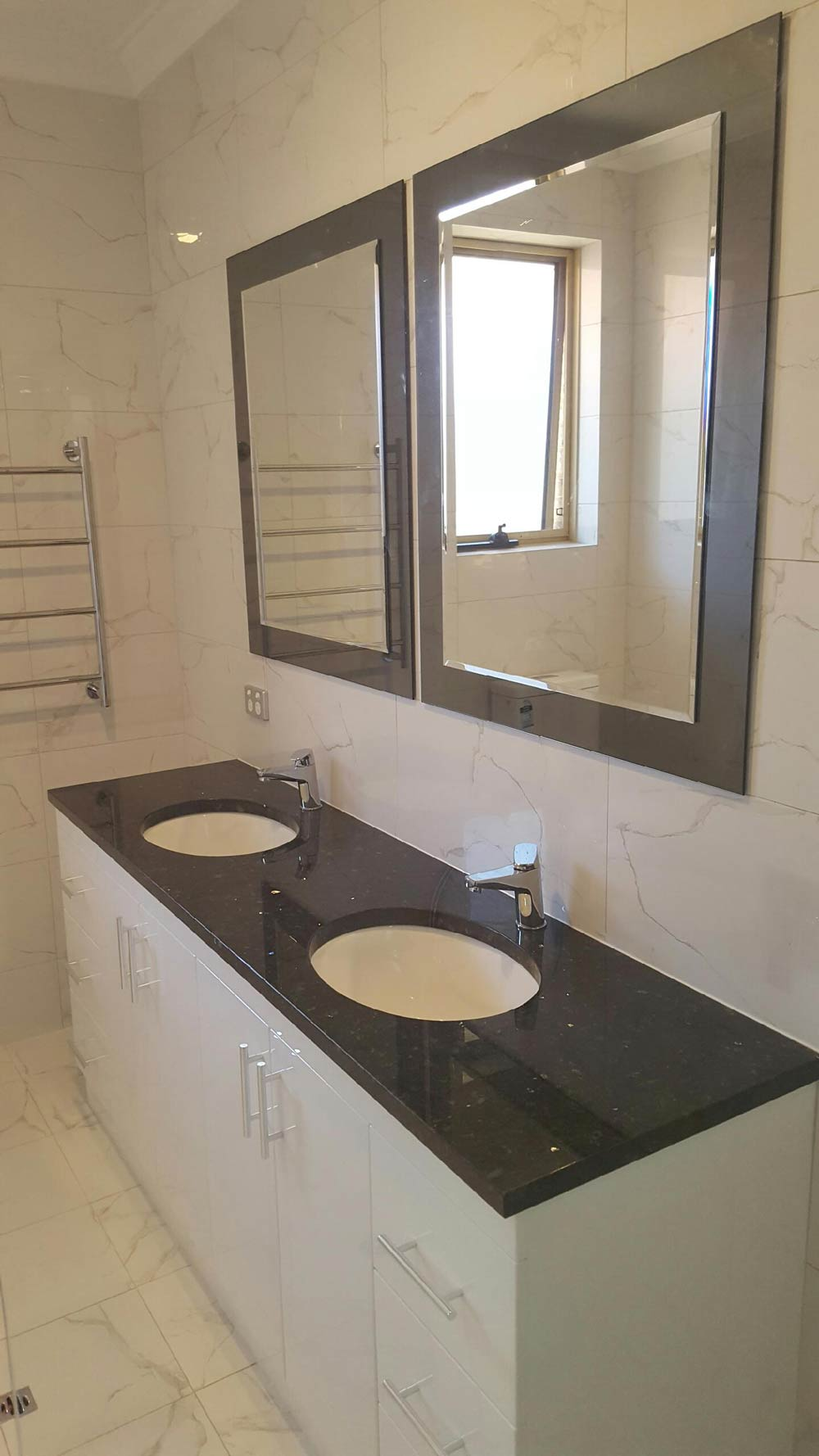 sink with two mirrors above