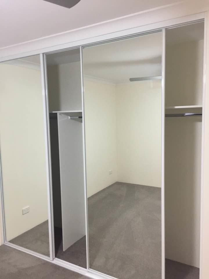closet with a sliding mirror door