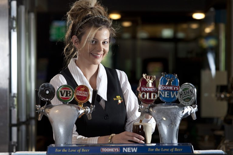 Lady pouring beer