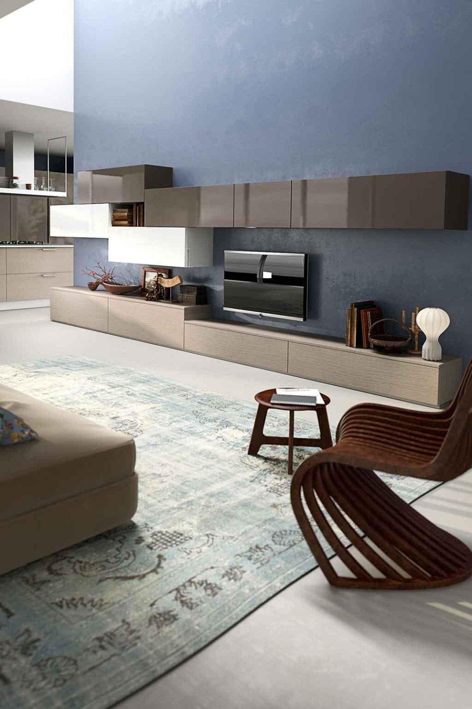 Progetto zona tv con arredi cucina