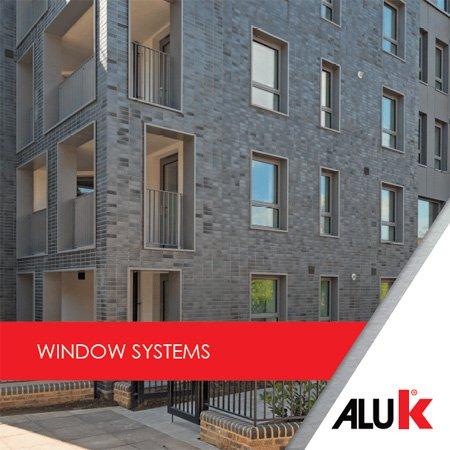 Grey bricked block of flats with new windows