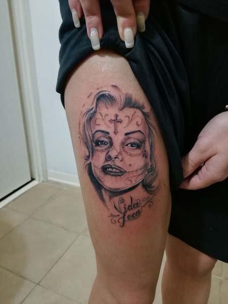 Tatuaggi volto donna