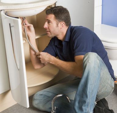 One of the expert plumbers fixing a sink in Kaitaia