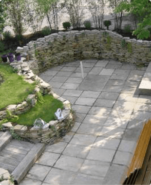A patio and stone wall