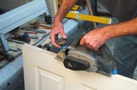 carpenter working on a door