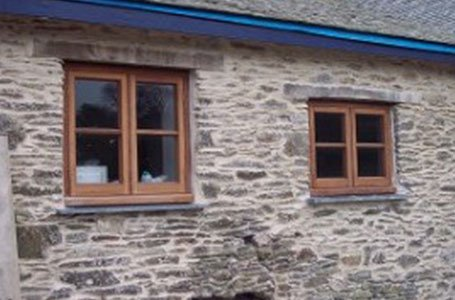 stone wall with wooden frame windows