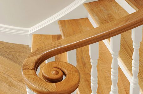 curved wooden railing with white balustrade