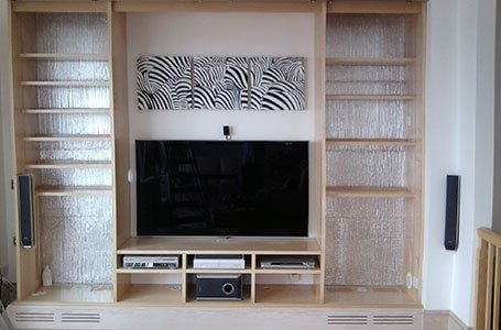 wooden shelf with television