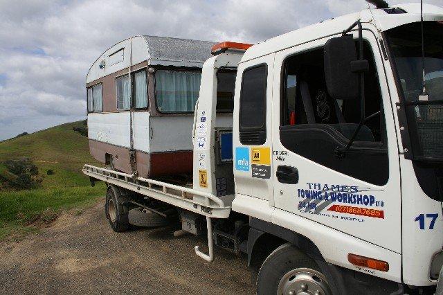 Truck towing caravan