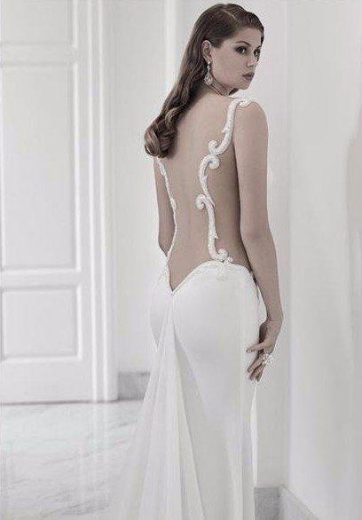 abito bianco ricamato alta moda
