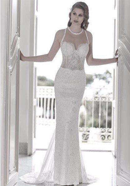 abito bianco ricamato alla moda