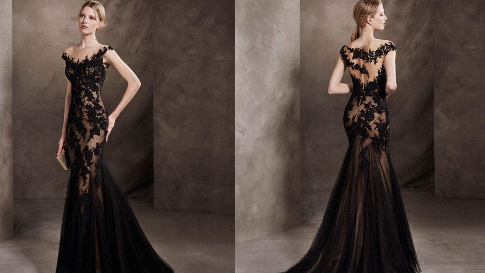 una modella con un abito in pizzo dl color nero
