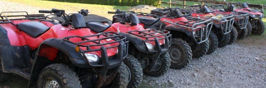 Quad bikes lined up and ready for quad bike rides in Taranaki