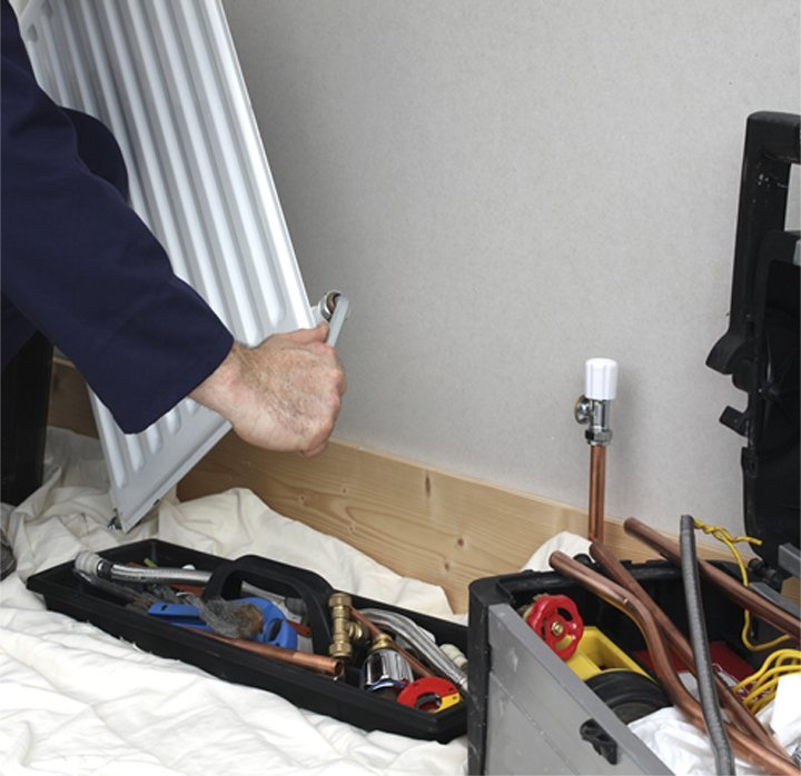 Engineer repairing a radiator