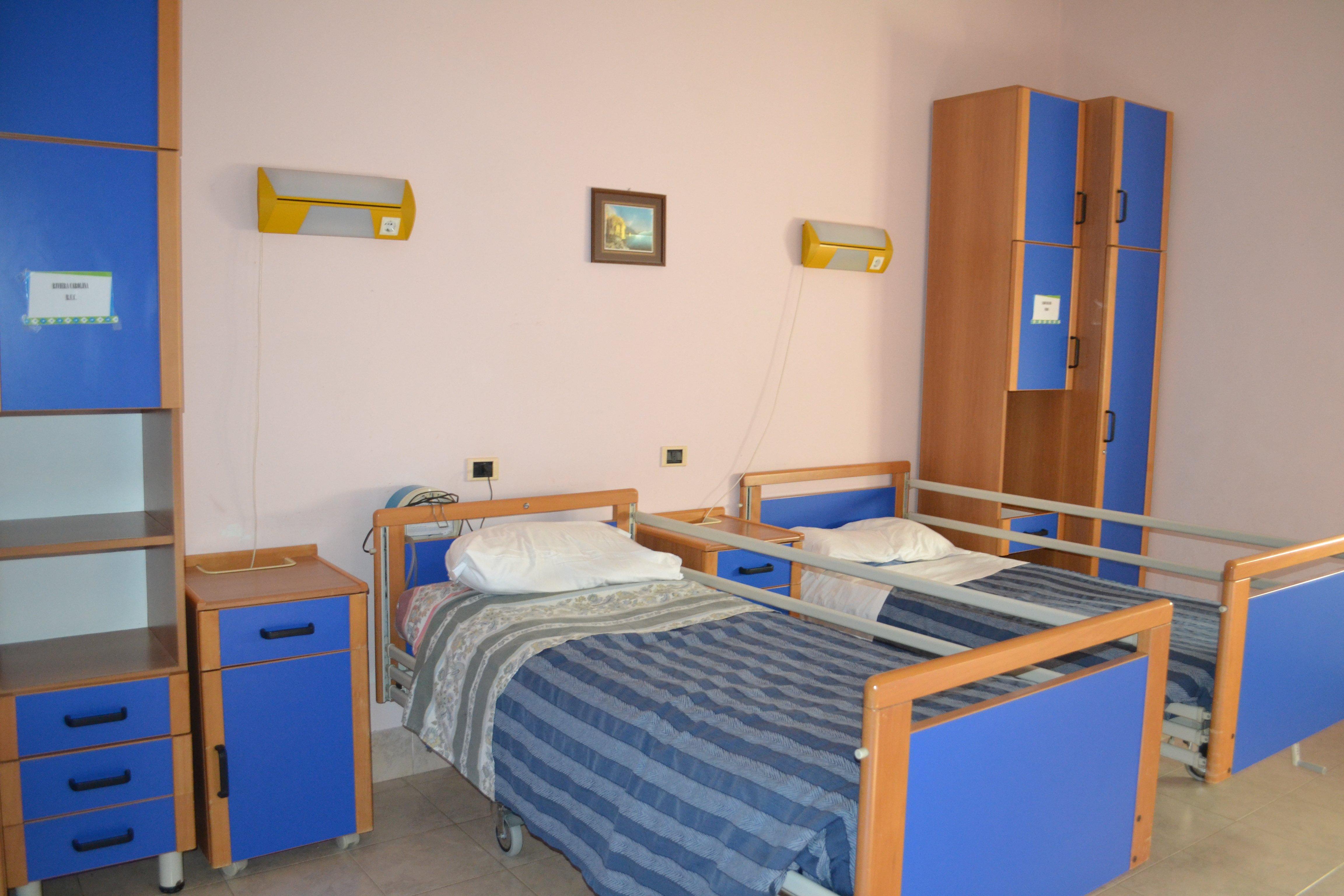 camera con letti blu