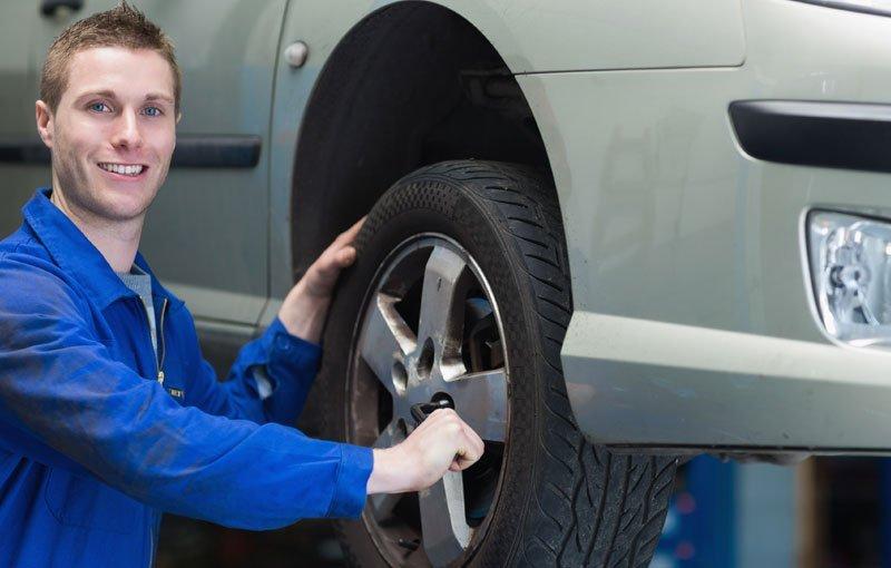 man fixing tyres