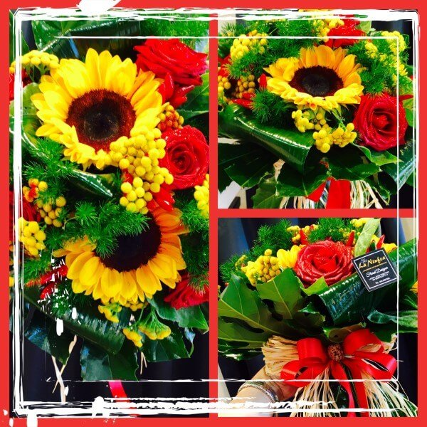 bouquet girasoli e rose rosse