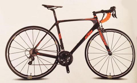 una bici da corsa nera, arancione  e grigia KTM