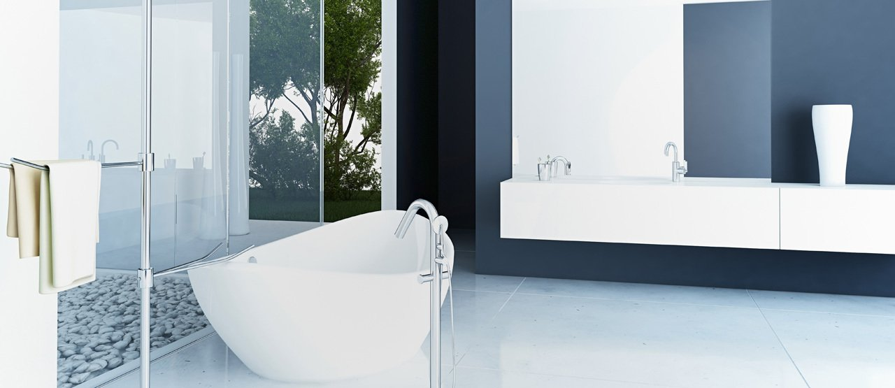 Bathroom in white and shades of grey, with white free standing oval bath
