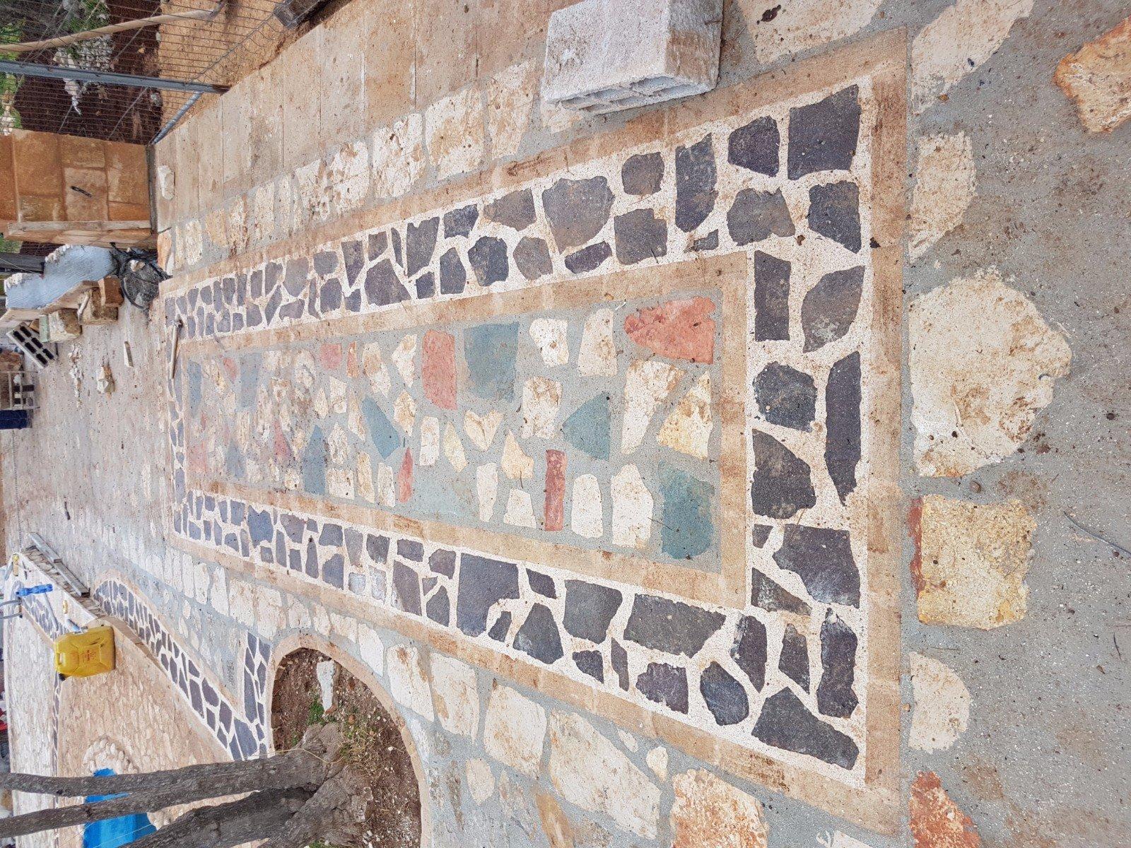 Mosaico su muro
