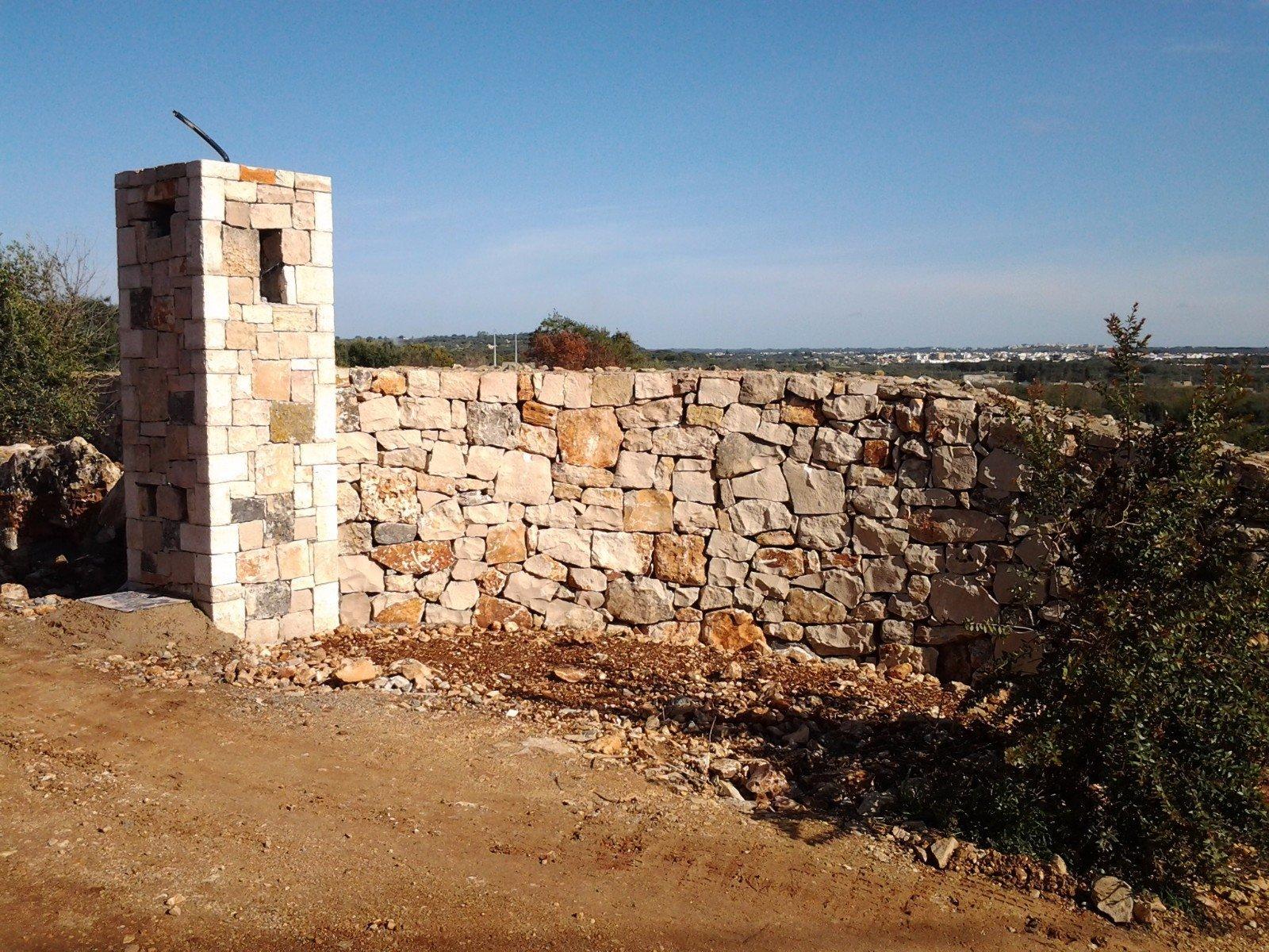Muro esterno in pietra a vista
