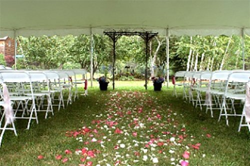 White frame chairs at event  in Webster, NY