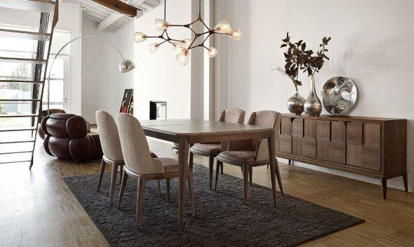 sala da pranzo con tavolo e sedie in stile contemporaneo