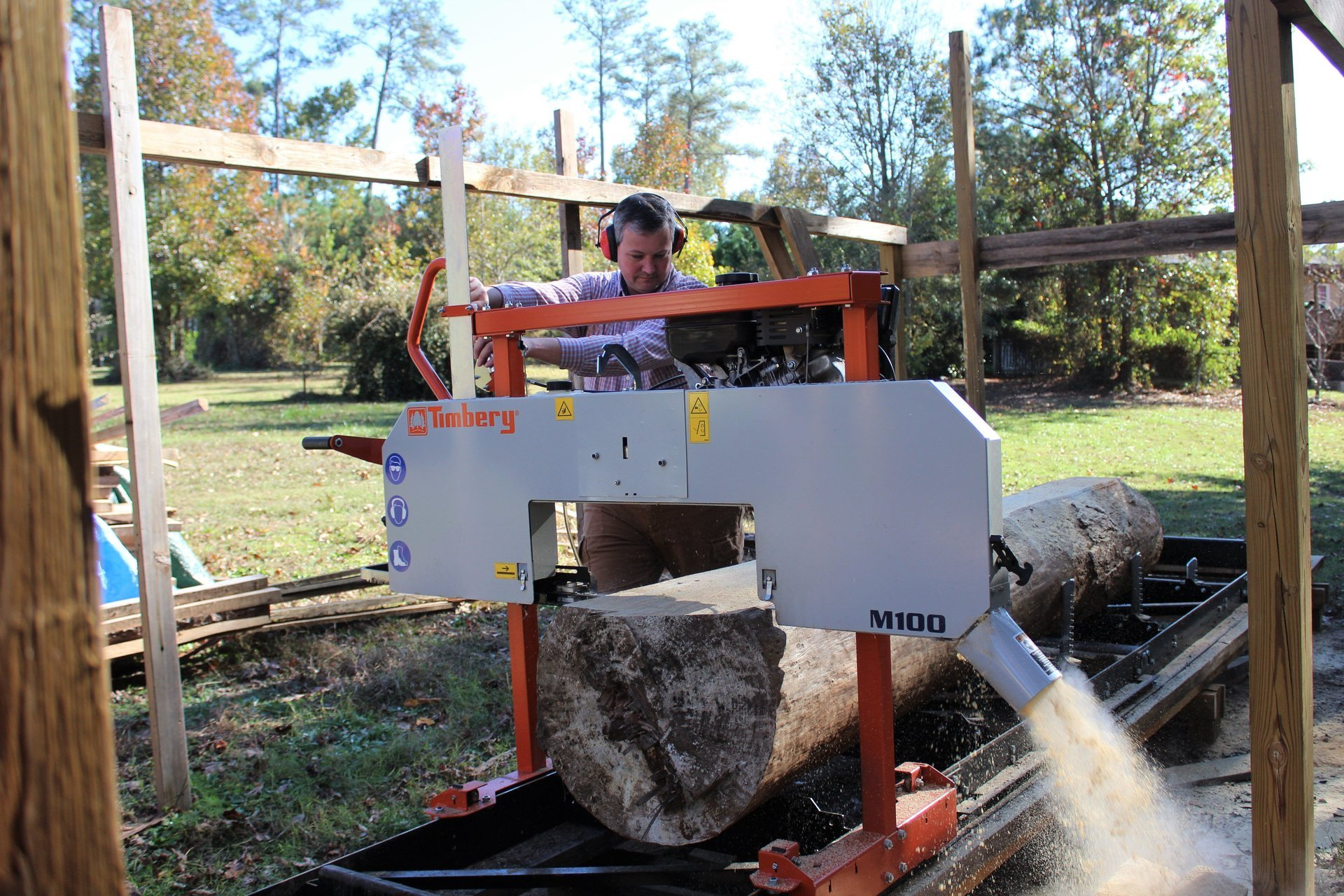 Dee Farmer sawing lumber for projects on his North Carolina hobby farm.