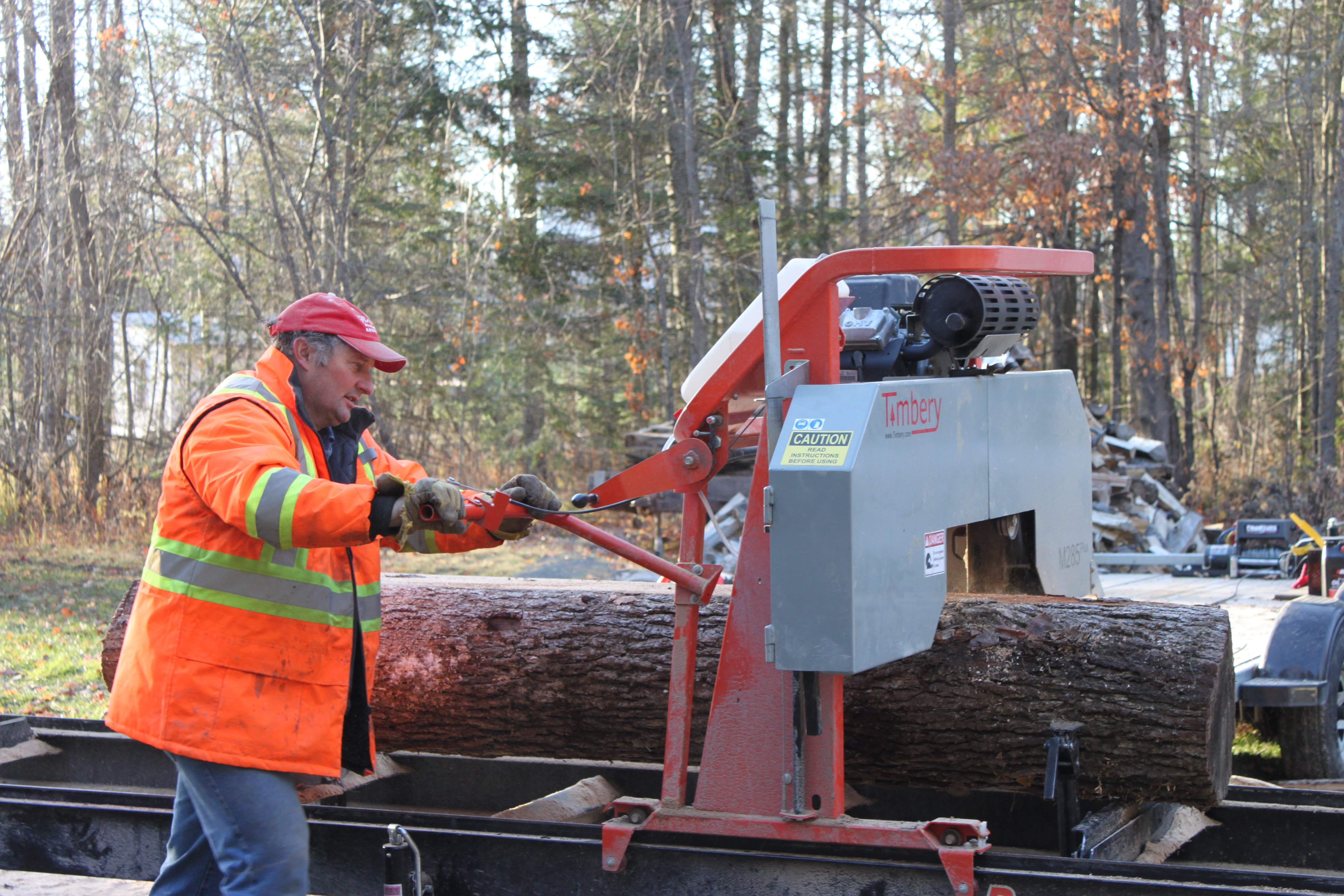 Bruce McEwen sawing on a Timbery Portable Sawmill