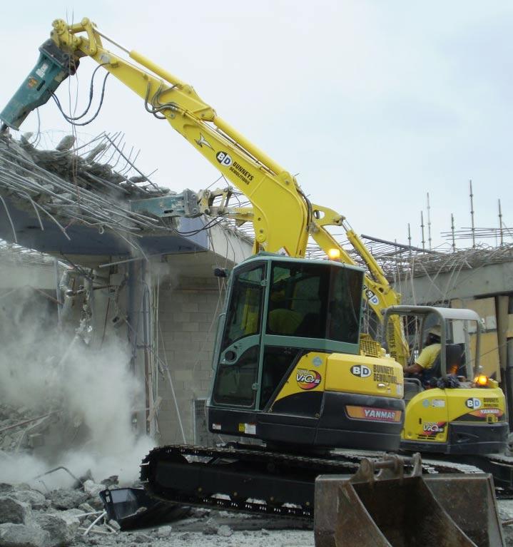 northside demolitions digger demolishing the building