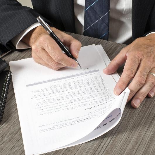 A man signs an insurance document