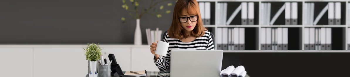Lady wearing glasses and using a computer