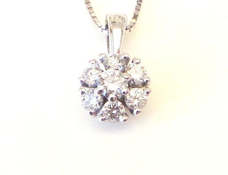 Cattelan - ciondolo a griffes con diamanti.