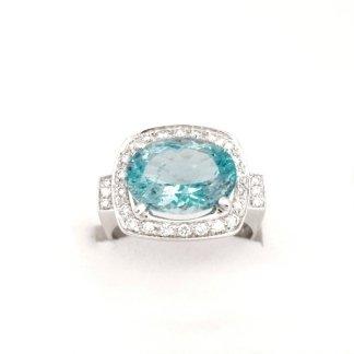 anello in oro bianco 750 con diamanti e topazio azzurro modello rbt19
