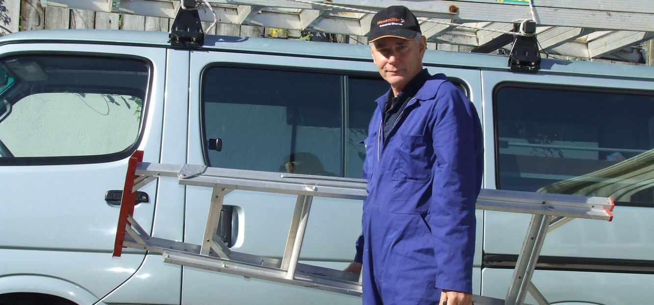Our electrician by his van in Auckland