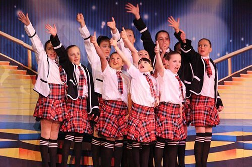 Group of school girls performing on stage