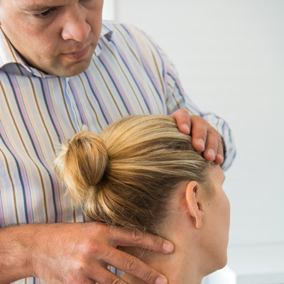 Adrian Chiropractor Treating Patient