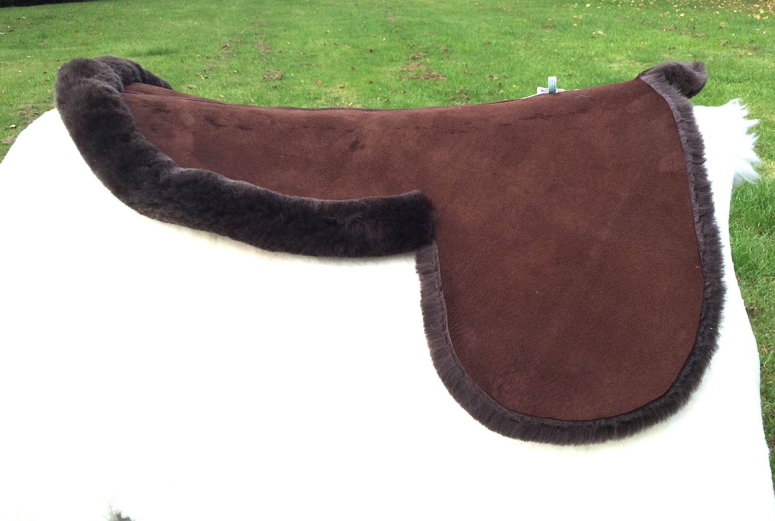 Offside of Dark Brown Side Saddle Numnah with Turned Edges around seat only