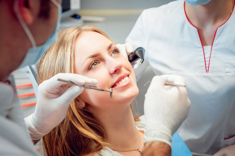 Young smiled woman at the dental office