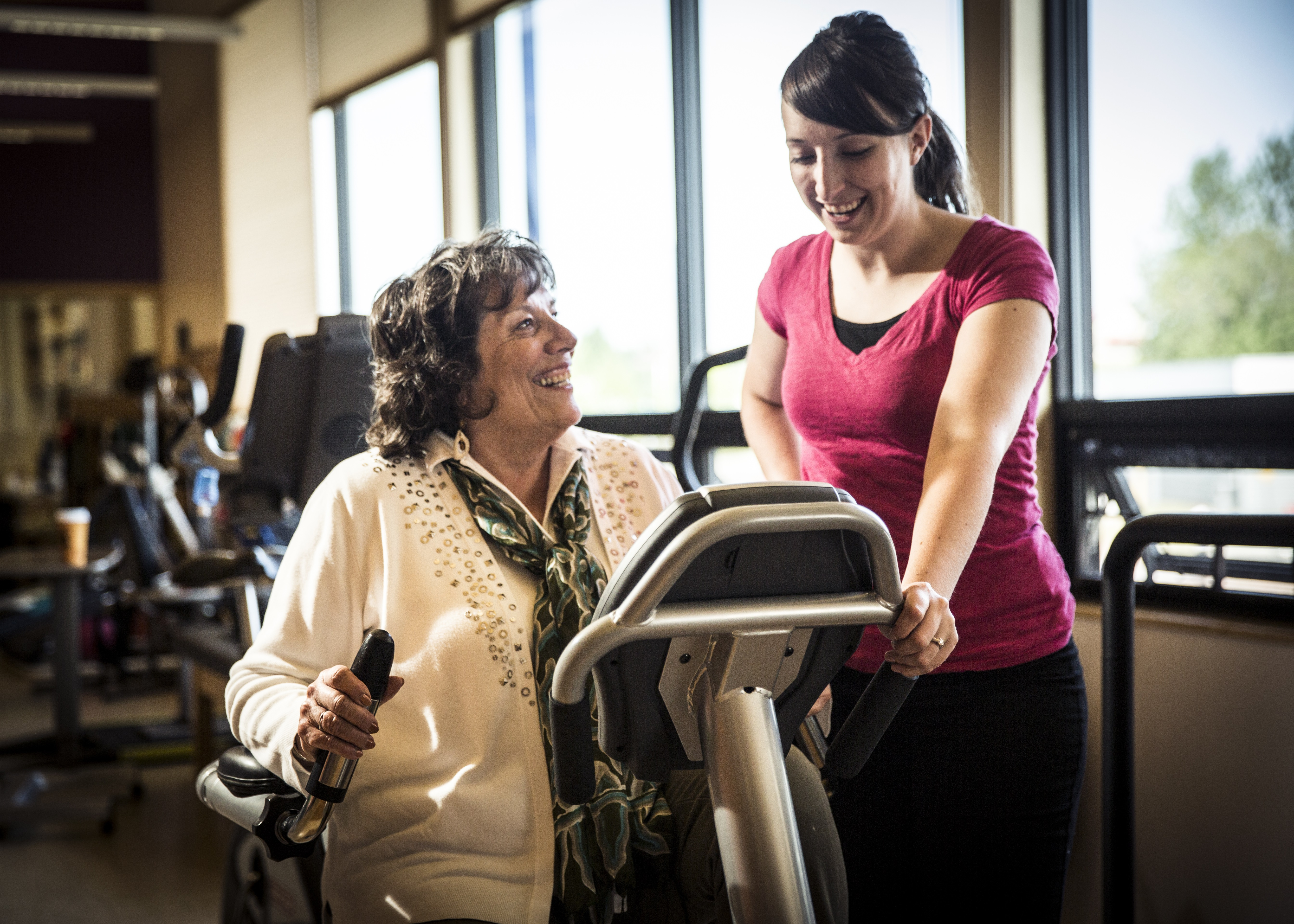 Woman exercising with a physical therapist in AK
