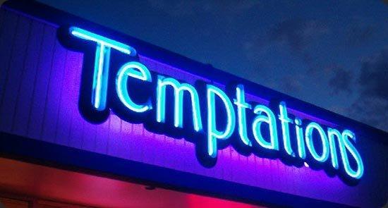 insegna luminosa con scritto Temptations
