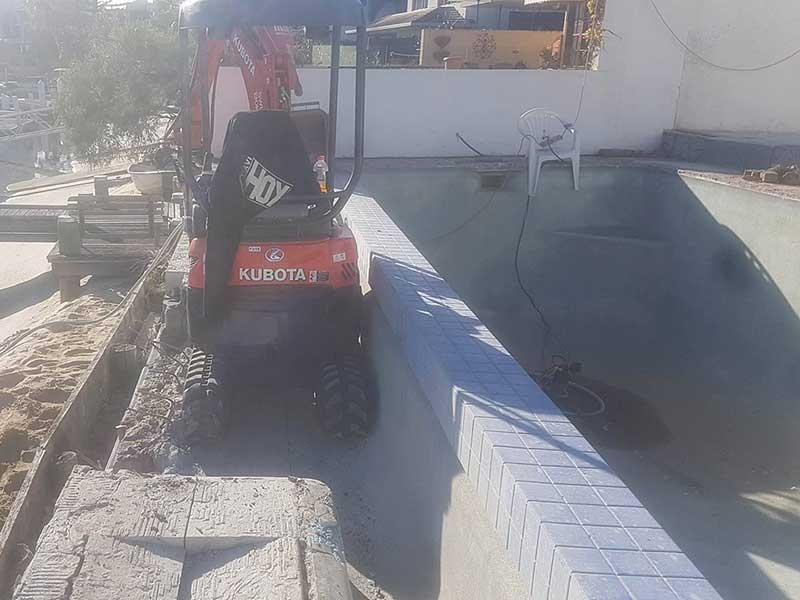 excavator beside wet soil