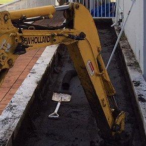 excavating hole with shovel