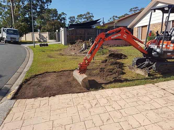 KUBOTA excavator removing the grass