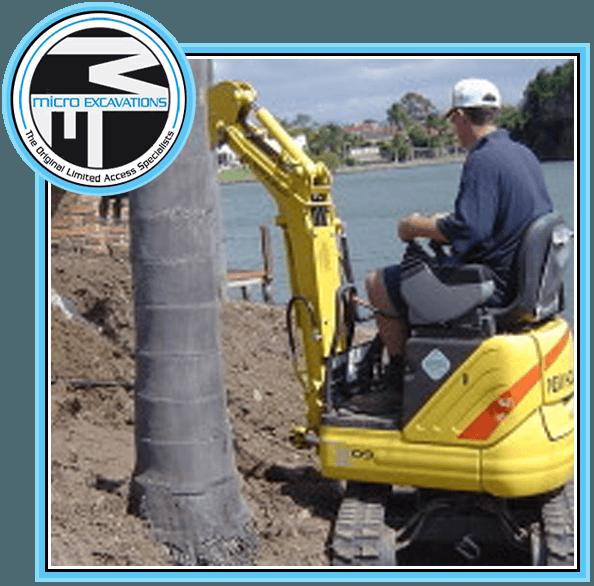 man operating yellow micro excavator