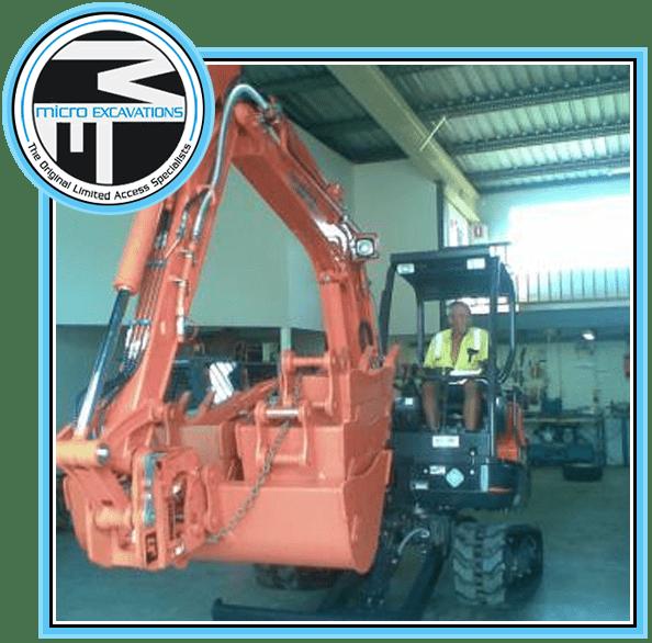 man operating orange XX913 excavator